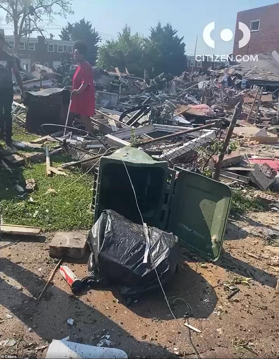 At least one person has been killed and another two are in a critical condition after a 'major explosion' destroyed at least three homes in Baltimore and trapped victims, including children, under the rubble. Pictured: the scene