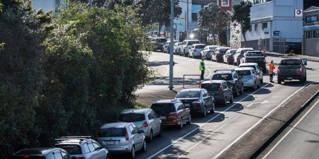 Cars line up outside a COVID-19 testing center in Auckland, New Zealand, on Thursday. (AP)