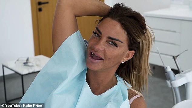 Ha!Before having the treatment done, Katie put on a playful display as she seductively posed and flipped her hair back and forth while flashing her metal teeth