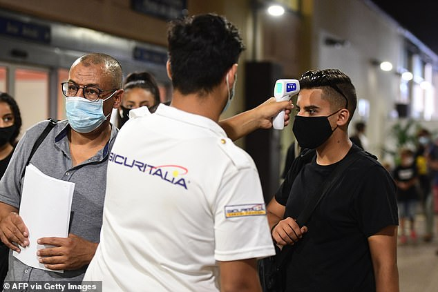 Passengers of the first cruise ship to set sail from Italy since the coronavirus lockdowns were required to have their temperatures checked, and to be tested before being allowed to board