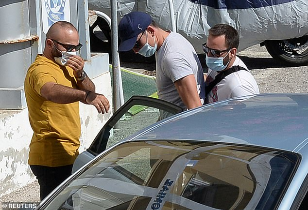Maguire was spotted being taken into a Greek police station after being arrested in Mykonos