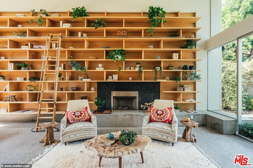 A better look: There is plenty of space for parties with a wide fireplace for cozy evenings and built-in light wood bookshelves to store her favorite page turners as well as knickknacks
