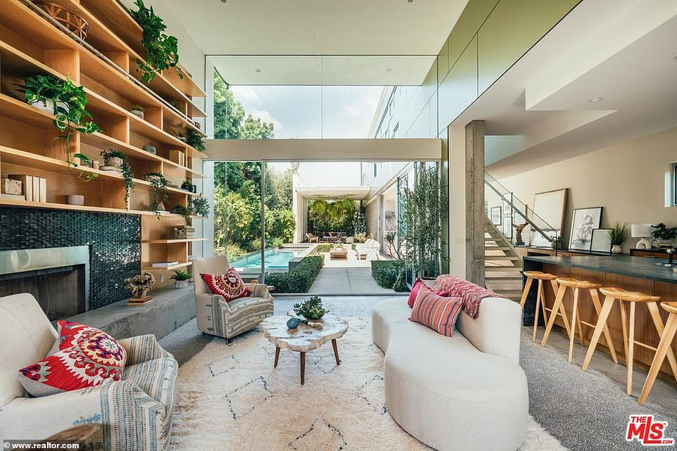 Party zone: The best room in the house is the oversized living room with 15-foot ceilings and a glass wall that looks out to the back yard