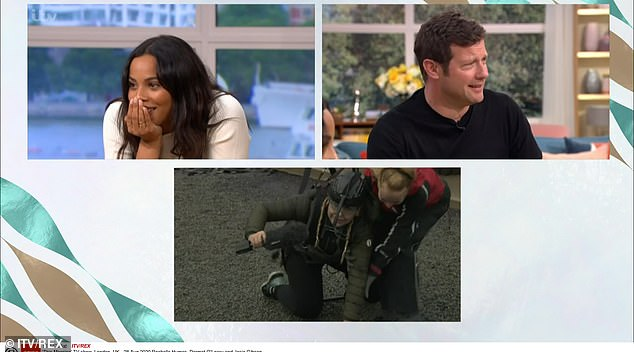 Struggle: Back on land, Josie struggled to get out of her harness with the help of someone who worked at the attraction before talking to Rochelle Humes and Dermot O'Leary