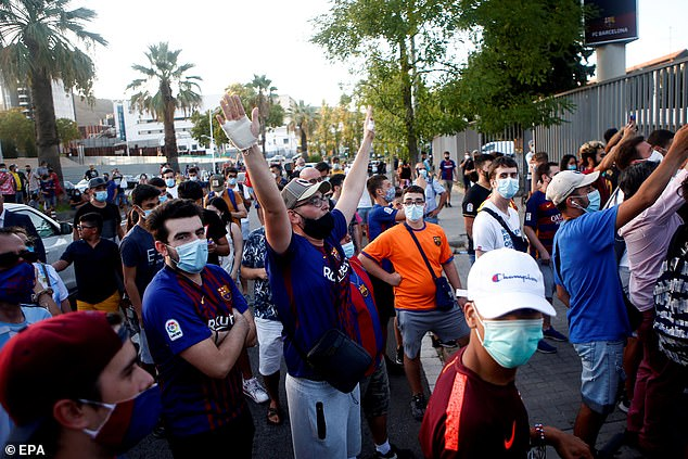 Barcelona supporters gathered around the Nou Camp to protest against their under-fire board