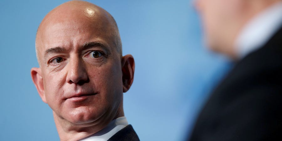 Amazon protesters set up guillotine exterior Jeff Bezos' dwelling