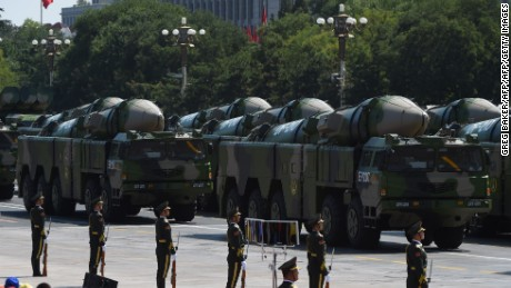 Military vehicles carrying DF-21D missiles are displayed in a military parade at Tiananmen Square in Beijing on September 3, 2015.