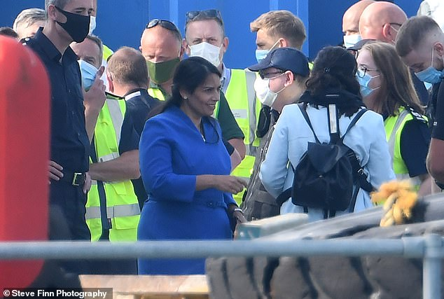 British Home Secretary Priti Patel, pictured visiting Dover on Monday, has sparked a diplomatic row with France by claiming thatmigrants were crossing the Channel to escape 'racist' France, where they feared they would be tortured