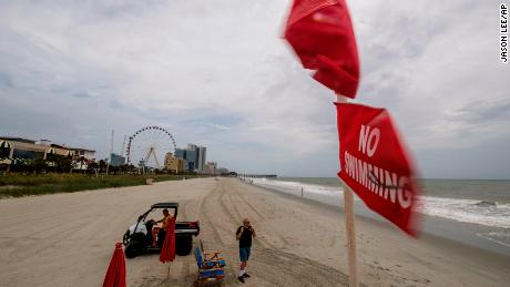 No swimming flags fly over a lifeguard stand in downtown Myrtle Beach, South Carolina on Monday, August 3, 2020.