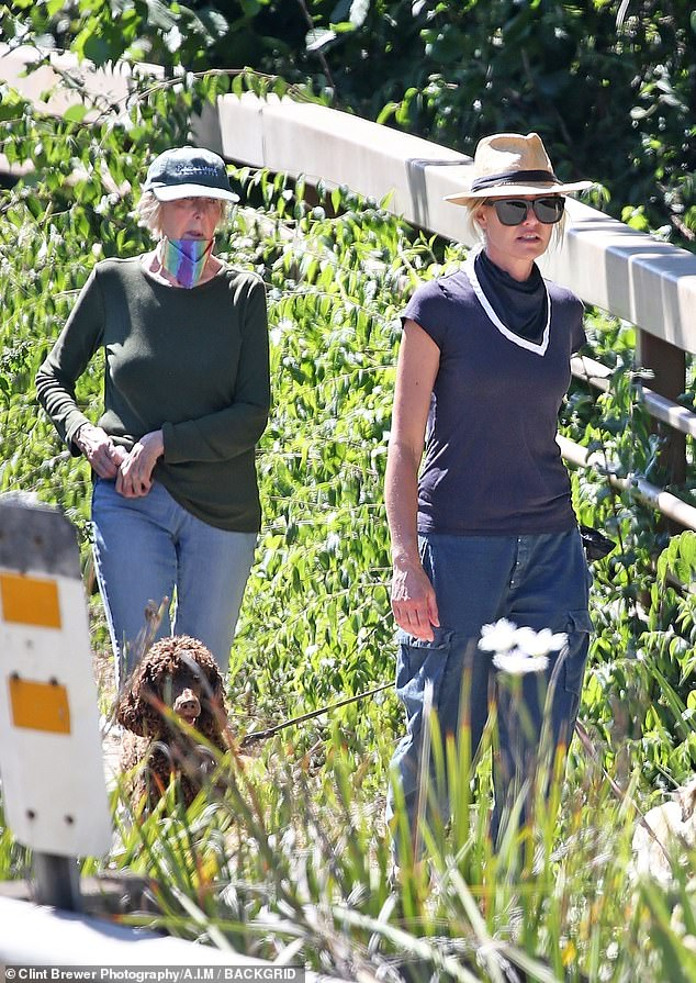 The latest: Portia de Rossi, 47, who's the wife of talk show host Ellen DeGeneres, 62, was seen hiking with her mother Margaret and her dogs Sunday in Santa Barbara, California