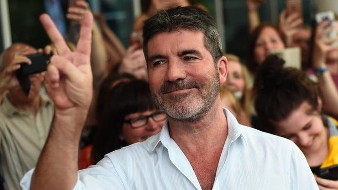 Simon Cowell is recuperating after breaking his back in a tumble off an electric bicycle.