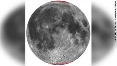 Enhanced map of hematite (dust) on the moon, outlined in red using a spherical projection of the near side.