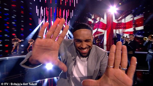 Smooth moves: BGT winner Ashley Banjo fills the chair of jury Simon Cowell, who is currently recovering from a strange bike accident in Los Angeles