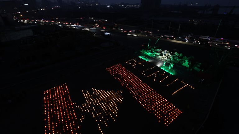 Paper lanterns in the shape of a Lebanese flag mark the one-month anniversary of the city's fatal explosion
