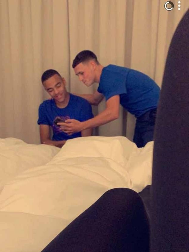 The two were captured on camera with two girls in their hotel room while they were staying in Iceland