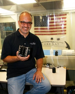 Jordi Puig-Suari holds CubeSat, which he invented with Stanford professor Bob Twigs.