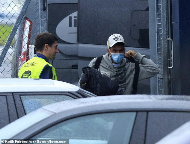 Alan was pictured arriving in Liverpool on Wednesday afternoon to close the transfer to Everton