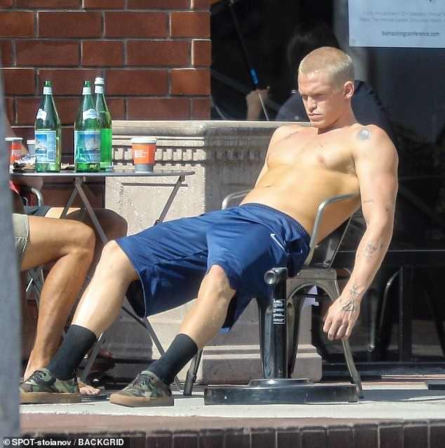 Why are you so gloomy? On Wednesday, Cody Simpson (pictured) looked sad during a coffee meeting with his friends in Venice, Los Angeles, after his split from Miley Cyrus.
