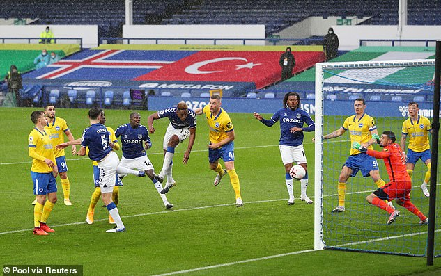 Yiri Mina turned his own header in stoppage time in the first half to restore Everton's lead