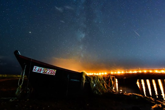 Vladivostok, Russia? October 10, 2018: A meteor breaks through the night sky over Rusky Island during the Draconide meteor shower. Yuri Smituk / TASS