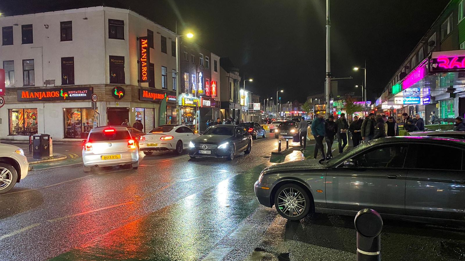 Bars and restaurants on Manchester's so-called Curry Mile were full on Friday night