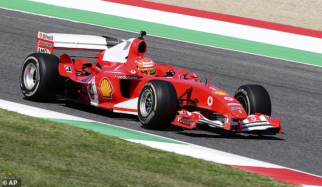 Mick Schumacher drives his father's Ferrari F2004 at a stage show at the Tuscan Grand Prix