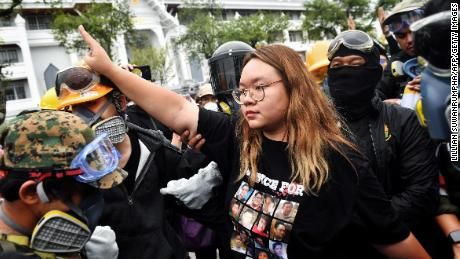 Panossaia protest leader & quot; Rong & quot; Sithijirawatanakul (center) performs the Hunger Games three-toed salute during a pro-democracy rally in Bangkok on September 20, 2020.