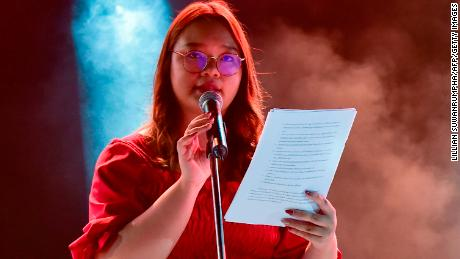 Banusaya Citigerawatanakul reads the list of demands including the repeal of the kingdom's strict royal defamation law during a pro-democracy rally at Thamasat University on August 10, 2020