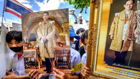 Protesters hold pictures of Thailand's King Maha Vajiralongkorn and his late father, King Bhumibol Adulyadej, during a pro-government and monarchy rally in Bangkok, July 30, 2020.