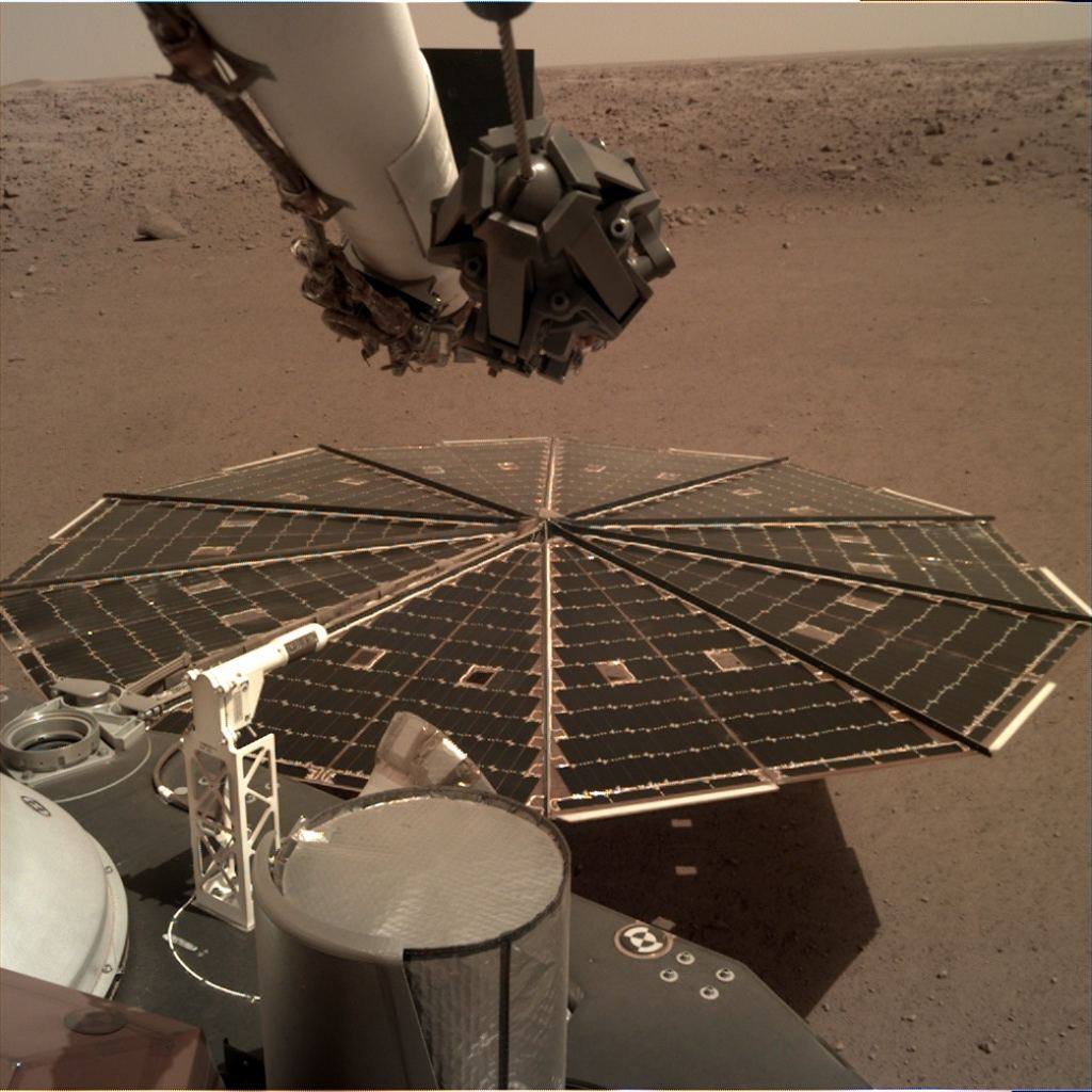 One of two 7-foot-wide (2.2 m) solar panels were photographed by the landing gear deployment camera, which is mounted on the elbow of its robotic arm. The accumulation of dust on the panels reduced the energy available to the mission. Source: NASA / JPL-Caltech