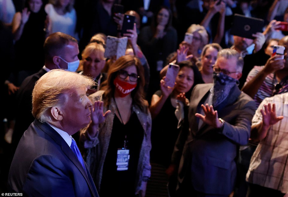 Worshipers stood around President Donald Trump and prayed for him in Nevada on Sunday as he attended mass at Las Vegas International Church.
