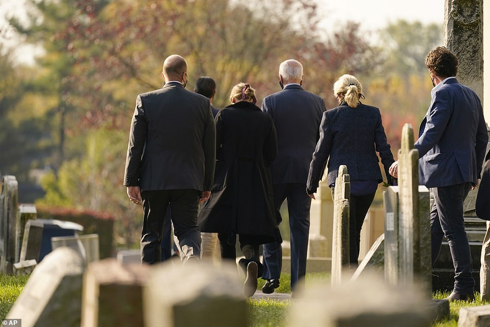 Joe Biden (center) leaves Mass with his wife Jill (second from right) and granddaughter Finnegan (second from left). The Biden family paid their respects to Beau Biden after church services