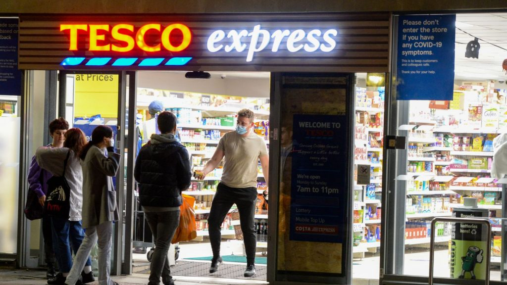 """BRISTOL, ENGLAND - OCTOBER 12: People are seen at Tesco Express on October 12, 2020 in Bristol, England. Despite the coronavirus infection rate in the city jumping from 44.2 new cases per 100,000 to 95.4 in the week ending Thursday, October 8, Bristol has been graded as medium or """"Tier 1"""" in the government's new three-tier Covid-19 alert system. Tier 1 means that the rule of six should be observed and that there is a 10 p.m. curfew on pubs and restaurants. (Photo by Finnbarr Webster/Getty Images)"""