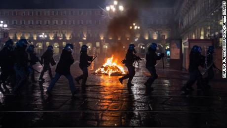 Clashes between protesters and police in northern Italy as anger over COVID-19 restrictions mounts
