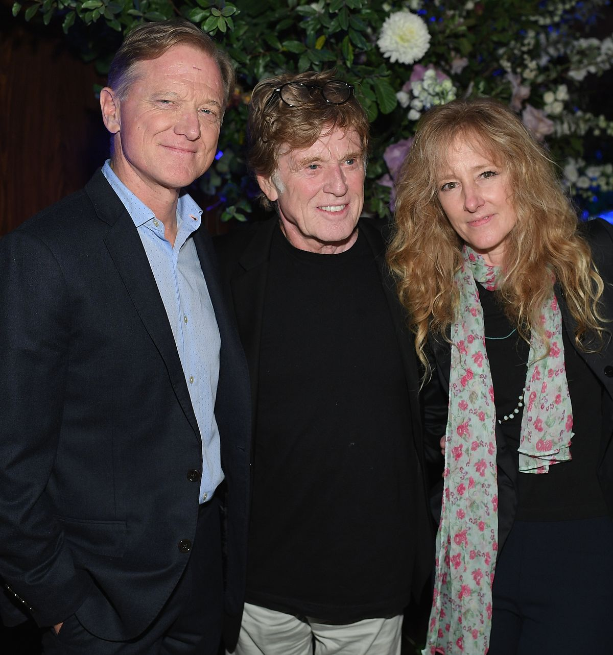 James Redford (L) and his parents Robert Redford and Shauna Redford attend the premiere of
