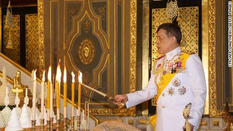 King of Thailand Maha Vajiralongkorn lights candles as he participates in a Buddhist celebration to celebrate the 2020 Kathina Festival at Wat Ratchabovate in Bangkok on October 10, 2020.
