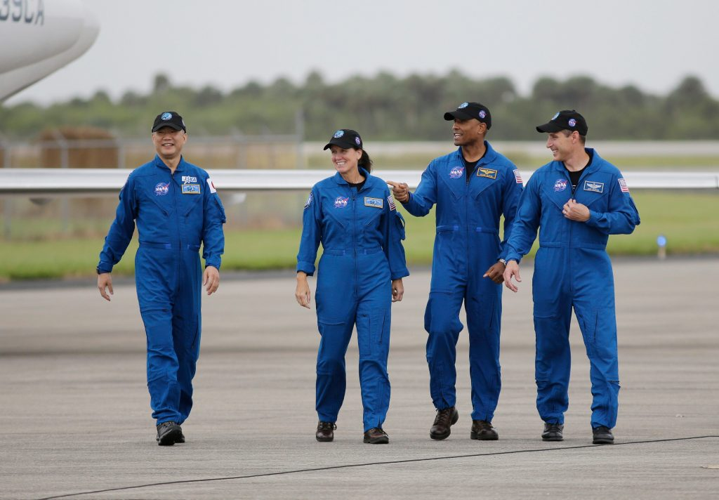 Astronauts head to the launch site of the SpaceX flight