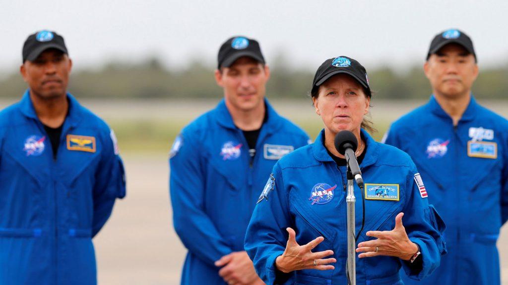 NASA astronauts Shannon Walker, Victor Glover, Mike Hopkins and JAXA astronaut Soichi Noguchi at Kennedy Space Centre