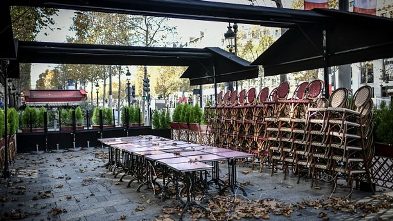 The Champs Elysees is largely deserted as restaurants and cafes around the country have closed