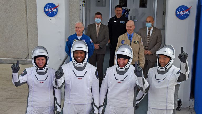 Cape Canaveral, Florida - November 15: (LR) NASA astronauts, mission specialist Shannon Walker, Commander Victor Glover, Commander Mike Hopkins, mission specialist from Japan Aerospace Exploration Agency (JAXA), and astronaut Sochi Noguchi leave operations and check-out Building November 15, 2020 on their way to A SpaceX Falcon 9 rocket with the Crew Dragon spacecraft on the launch pad 39A at the Kennedy Space Center on November 15, 2020 in Cape Canaveral, Florida.  This will be the second launch of an astronaut from US soil by NASA and SpaceX and the first operational mission called Crew-1 to the International Space Station.  (Photo by Red Huber / Getty Images)