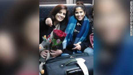 Lina Al-Hathloul and her sister Loujain pose for an undated photo on a train from Brussels.