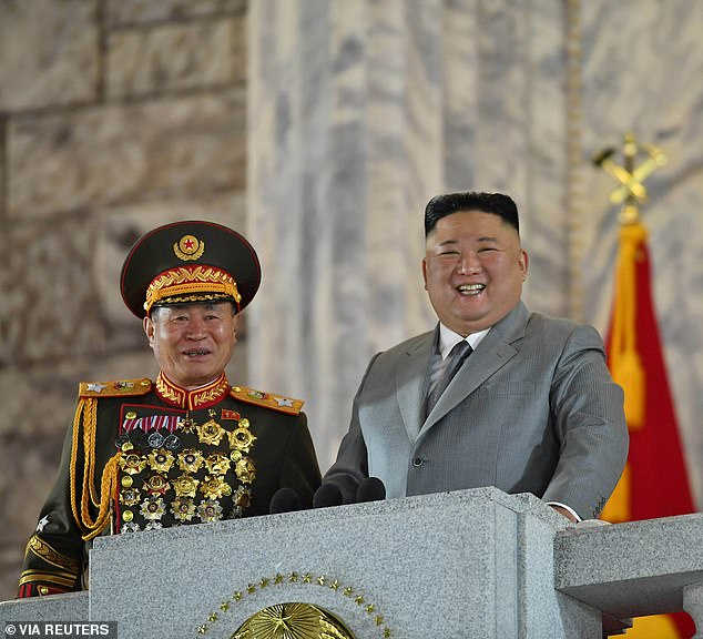 Christian activist Tim Peters claimed that `` quarantine camps '' for Coronavirus have been set up in cities near the Chinese border. Above, North Korean leader Kim Jong Un smiles during a ceremony marking the 75th anniversary of the country's ruling party in Pyongyang on October 10.
