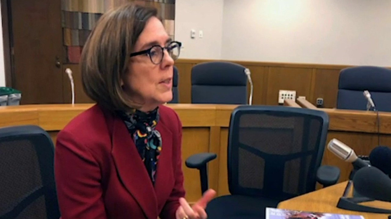 The Oregon governor tells residents to call police on people violating COVID restrictions