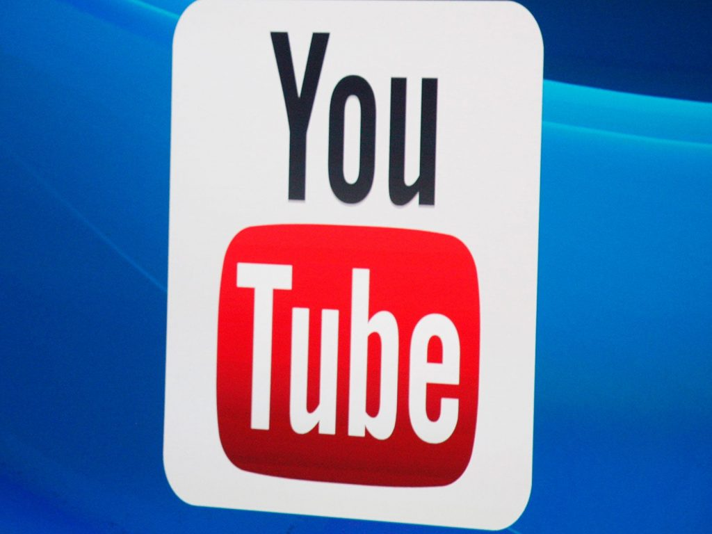 The YouTube logo on screen at E3 2014