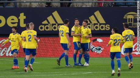 Cadiz players celebrate their opening goal against Barcelona.