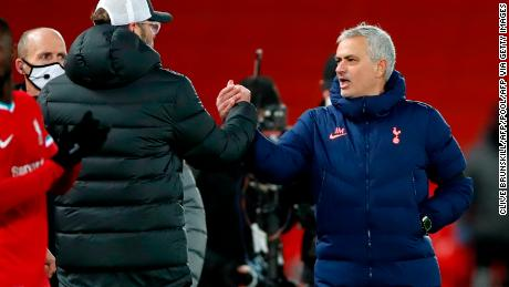 Jürgen Klopp shakes hands and exchanges words with Jose Mourinho after the match.