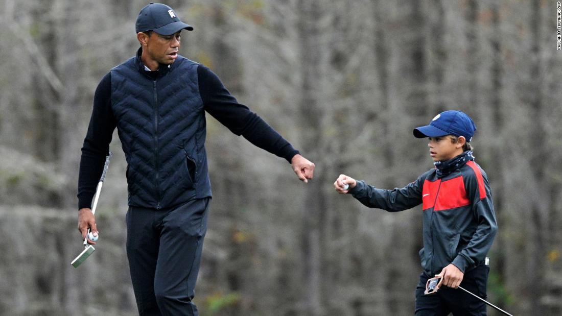 Tiger Woods is doing a warm-up with his 11-year-old son Charlie, and the similarities are stunning