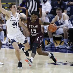 BYU goalkeeper Connor Harding (44) defended Texas South striker Justin Hopkins (15) during the Cougars' 87-71 victory at the Marriott Center in Provo on Monday December 21, 2020.