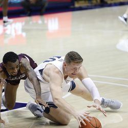 BYU striker Kolby Lee (40) dives to the ground for a loose ball as Cougars 87-71 beat Texas Southern at the Marriott Center in Provo on Monday, December 21, 2020.