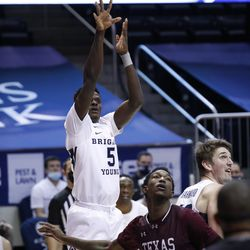 BYU striker Gideon George (5) places a shot against South Texas striker Gordon Carl Nicholas (5) during the Cougars 87-71 victory at the Marriott Center in Provo on Monday, Dec. 21, 2020.